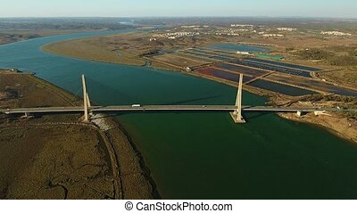 Aerial. Bridge over Guadiana view from sky. Border Spain...