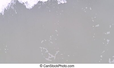 Aerial camera following tidal wave, view from above. Slow...