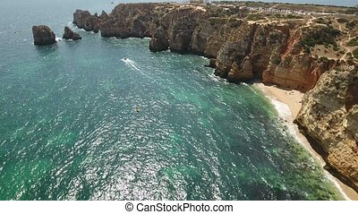 Aerial. Cape Lighthouse Ponta da Piedade shot in the air video.