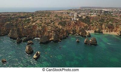 Aerial. Cape POnta de Piedade from the sky drone shot of beach time.