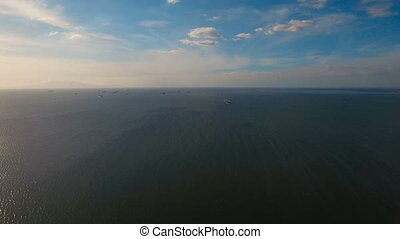 Aerial Cargo ships anchored in the sea. Philippines, Manila.
