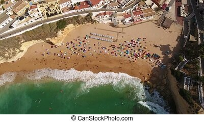 Aerial. Carvoeiro beach view from the sky, tourists on vacation. Portugal.