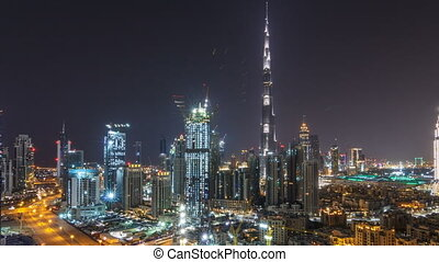 Aerial cityscape timelapse at night with illuminated modern architecture in Downtown of Dubai, United Arab Emirates.