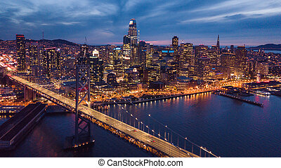 Aerial Cityscape view of San Francisco and the Bay Bridge at Nig
