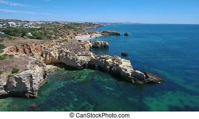 Aerial. Cliffs and beaches of the coast of Albufeira filmed from the sky.