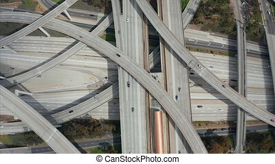 AERIAL: Close Flight over Judge Pregerson Huge Highway Connection showing multiple Roads, Bridges, Viaducts with little car traffic in Los Angeles, California on Beautiful Sunny Day