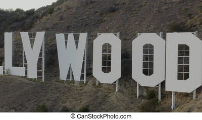 AERIAL: Close Up of Hollywood Sign Letters at Sunset, Los Angeles, California HD
