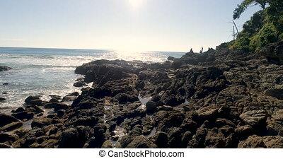 Aerial closeup view of rocks near the sea