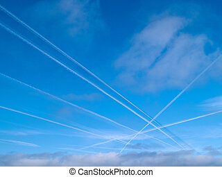 Aerial crossroad sky with jets contrails traffic