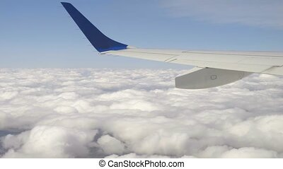 Aerial cumulus cloudscape - View from the cabin porthole of...