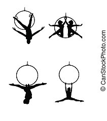 aerial dancers - dancers and acrobats hanging from hoops and...