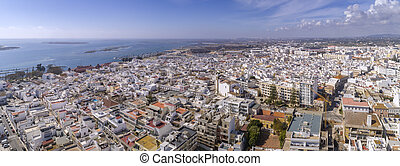 Aerial daytime view of Olhao downtown, waterfront to Ria ...