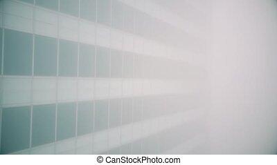 Aerial descending shot of office building in fog - Aerial...