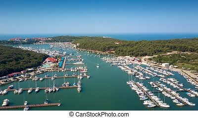 Aerial descending shot of the Adriatic sea marina and yachts...