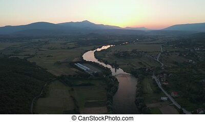 Aerial descending shot of the river Cetina, Croatia - Stream...