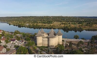 Aerial dolly shot of medieval fort in Soroca, Republic of Moldova at sunset. Fort built in 1499 by Moldavian Prince Stephen the Great. Renovated in 2015