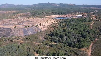 Aerial dolly zoom over abandoned slate mine - Dolly zoom...
