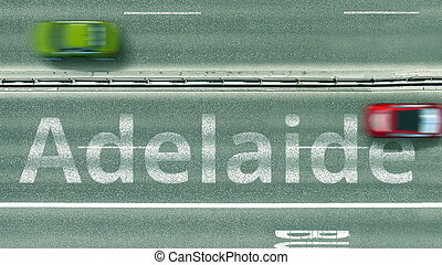 Aerial down view of the motorway with cars revealing Adelaide caption. Car travel to Australia 3D rendering