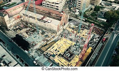 Aerial down view shot of a city construction site