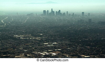 Aerial, Downtown Los Angeles - Smoggy aerial view looking...