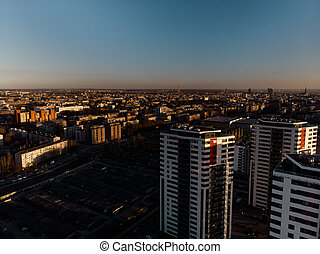 Aerial dramatic scenery sunset with a view over skyscrapers in Riga, Latvia - Old Town downtown is visible in the background