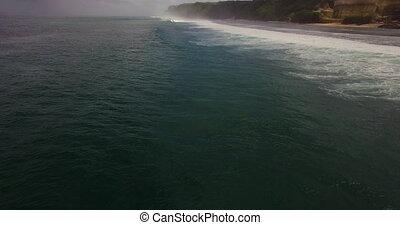 Aerial drone 4k footage of ocean waves breaking before the...