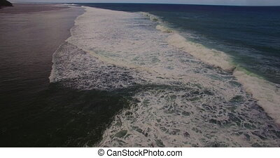 Aerial drone 4k footage of ocean waves breaking before the...