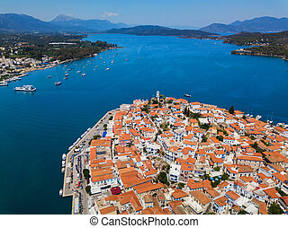 Aerial drone bird's eye view photo of Poros island a famous bay and yacht harbor with calm waters, Greece