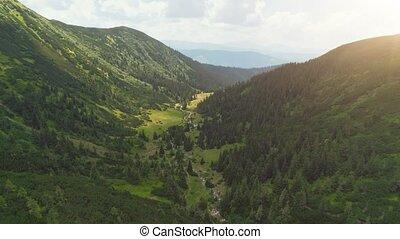 Aerial Drone Flight: beautiful mountain landscape. Green...
