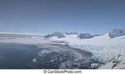 Aerial drone flight over Antarctica shoreline.