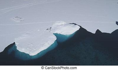Aerial drone flight over Antarctica shoreline.