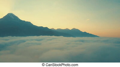 Aerial Drone Flight Over Mountain Range Through Clouds At...