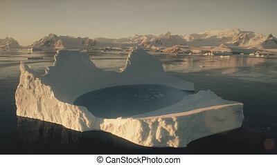 Aerial drone flight over the iceberg. Antarctica.