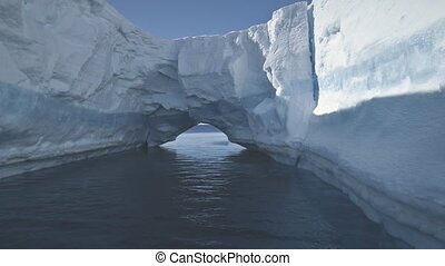 Aerial drone flight to Antarctica iceberg arch. - Aerial...