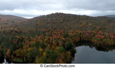 Aerial Drone - Fly Over Lake And Hillside Filled With Fall...
