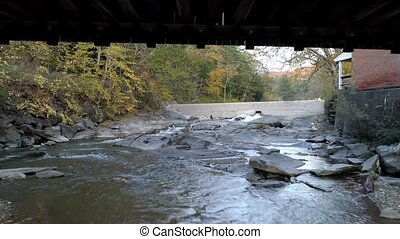 Aerial Drone - Fly Under Weathered Covered Bridge in Fall in...