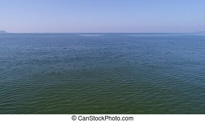 aerial view, advance in of calm, blue sea - aerial drone...