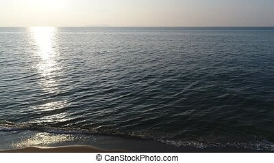 aerial view, advance in of calm, evening sea - aerial drone ...