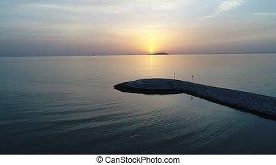 aerial drone flying, breakwater of stone in the sea - aerial...