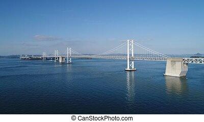 Aerial drone flying, descent in of calm, Seto-bridge -...