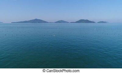aerial drone flying, marine fishing net culture - aerial...