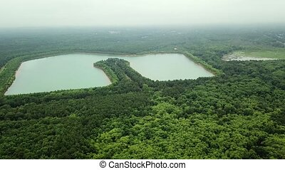 Aerial Drone footage, flying forward over lakes and forest, .Aerial View of beautiful landscape
