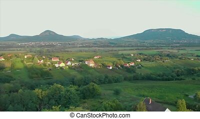 Aerial drone footage from a Hungarian landscape with volcanoes, near the lake Balaton
