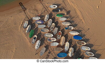 Aerial drone footage from harbor of small fisher boats, village Sant Antoni de Calonge from Spain, in Costa Brava