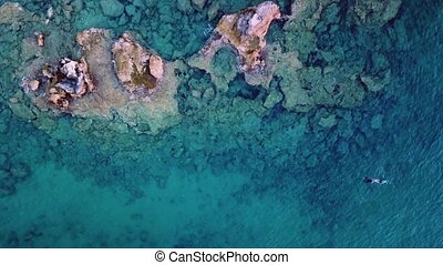 Aerial Drone Footage of a spearfisher in the Mediterranean Sea Top View