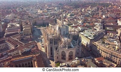 Aerial drone footage of famous statue on cathedral Duomo in Milan Italy