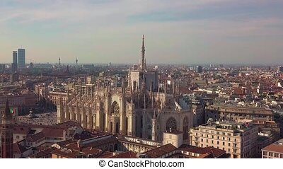 Aerial drone footage of famous statue on cathedral Duomo of...