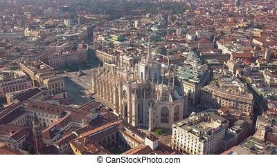 Aerial drone footage of famous statue on cathedral Duomo of Milan Italy