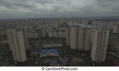 Aerial drone footage of gray dystopian urban area with identical houses 4K UHD