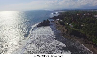 Aerial drone footage of Pura Tanahlot Temple on the Bali...
